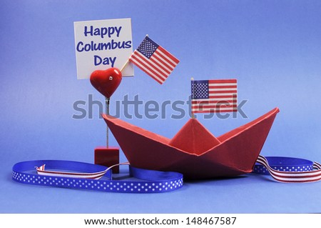 USA holiday, Happy Columbus Day, for the second Monday in October celebration Save the Date calendar with a red paper boat and stars and strips flags and ribbons decorations.