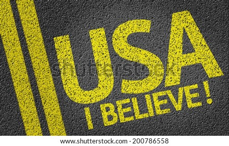 USA, I Believe! written on the road