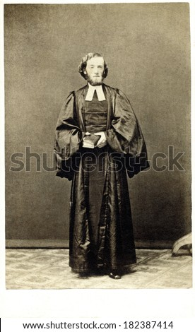 USA - ILLINOIS - CIRCA 1863 A vintage carte de visite photo of a priest or bishop dressed in style of the clergy. He is wearing a robe holding bible. Photo from the Civil War Victorian era. CIRCA 1863 - stock photo