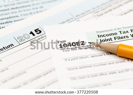USA IRS tax form 1040EZ for year 2015 with pencil and taken from above