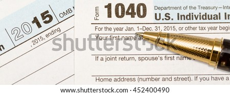 USA IRS tax form 1040 for year 2015 with gold ballpoint pen, Suitable for header image for tax preparer or accountant. Sized to fit a popular social media cover image placeholder - stock photo