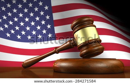 USA law and justice of The United States of America concept with a 3d render of a gavel on a wooden desktop and the flag of US on background. - stock photo