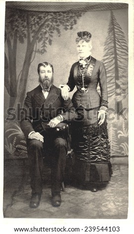USA MASSACHUSETTS CIRCA 1875  A Vintage Carte De Visite photo of a couple. He is sitting in a chair and she is standing. Photo from the Victorian era. CIRCA 1875