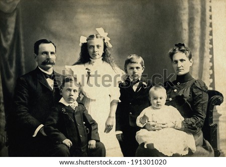 USA - MINNESOTA - CIRCA 1890 A vintage photo of a Victorian family. The parents are sitting with four children. The father has a mustache. This photo is from the Victorian era. CIRCA 1890 - stock photo