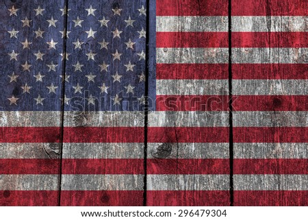 USA national flag on aged heavily grained wooden planks. - stock photo