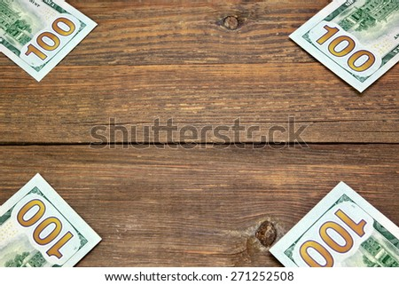 Usa New One Hundred Dollar Bills On The Rustic Rough Wood Table Textured Background - stock photo