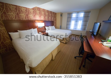 USA, NEW-YORK - 30 AUG, 2014: Light room with a two double bed and TV in Courtyard Washington Convention Center.