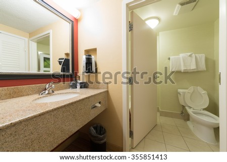 USA, NEW-YORK - 30 AUG, 2014: The interior of a bathroom with toilet and sink in Courtyard Washington Convention Center.