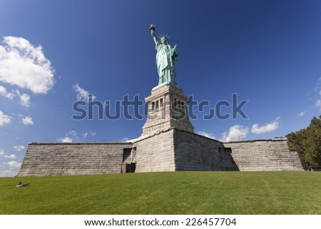 USA, NEW YORK, SEPTEMBER 8, 2014: Statue of Liberty at New York City is given the USA by France in 1885, standing at Liberty Island at Hudson river in New York. - stock photo