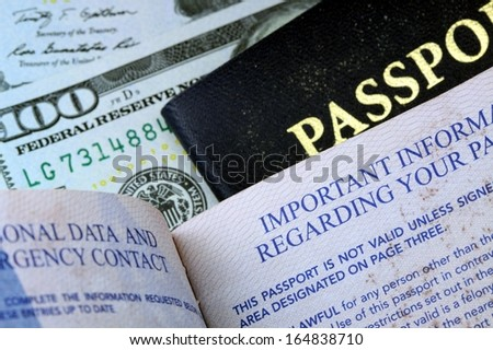 USA Passport with American Currency - stock photo