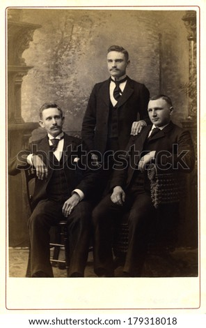USA - PENNSYLVANIA - CIRCA 1890 A vintage Cabinet Card photo of three young men. Two of the men have mustaches. They are dressed in Victorian style clothing. Photo is from the Victorian era CIRCA 1890 - stock photo