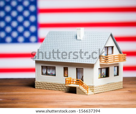 usa real estate concept: house against american flag - stock photo