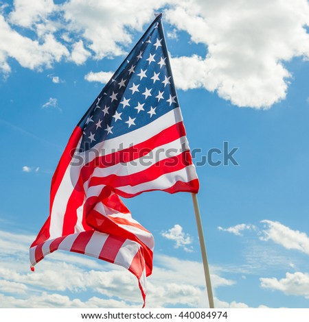 USA silky flag with clouds on background - stock photo