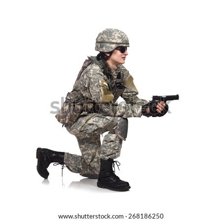 USA soldier shoots a gun  on gray background - stock photo