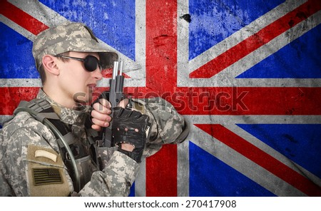 USA soldier with gun on a England flag background