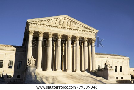USA Supreme Court building in Washington, D.C. with a blue sky background.