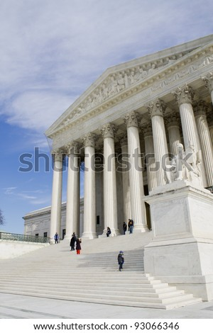 USA Supreme Court building in Washington, D.C. with a cloudy sky background.
