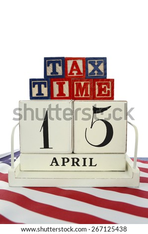 USA Tax Day, April 15, concept with vintage style calendar and Tax Time blocks on flag on blue wood background.  - stock photo