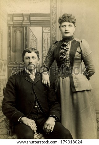 USA - VERMONT - CIRCA 1890 A vintage Cabinet Card photo of a young couple. They are dressed in Victorian style clothing. She is standing and he is sitting. A photo from the Victorian era. CIRCA 1890 - stock photo