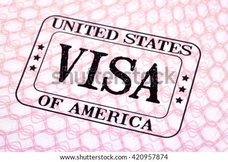 USA visa immigration stamp passport page, closeup - stock photo