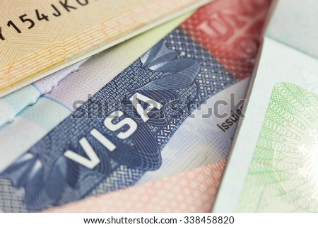 USA visa in a passport - selective focus - macro background - stock photo
