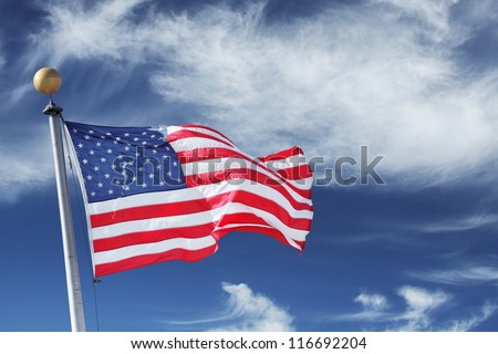 USA. Windblown flag of the United States of America over sky background. - stock photo