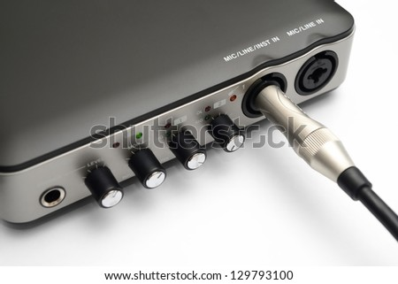 USB Audio Interface recording or Mixing by Computer AND Mono Cable Cord for Acoustic Electric Guitar - stock photo