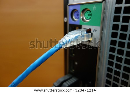 USB cable at connection port with soft focus and shallow depth of field - stock photo