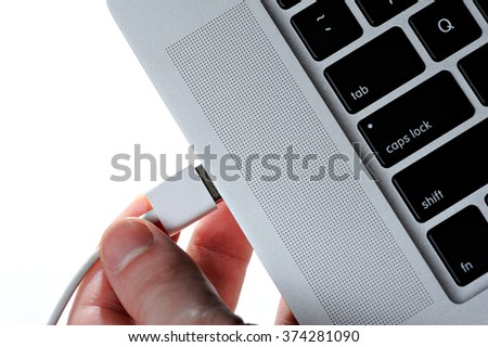 usb cable connect to laptop isolated on white - stock photo