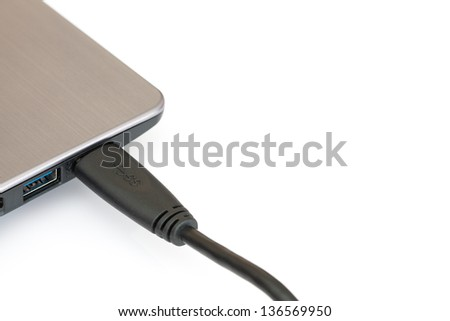 USB 3.0 device connecting to notebook on white background