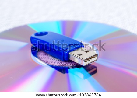 USB disk with DVD on binary code - stock photo
