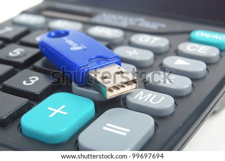 USB flash disk and calculator - stock photo