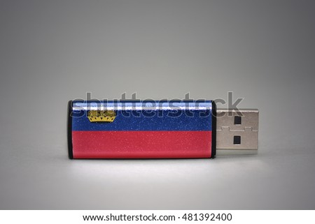 usb flash drive with the national flag of liechtenstein on gray background. concept