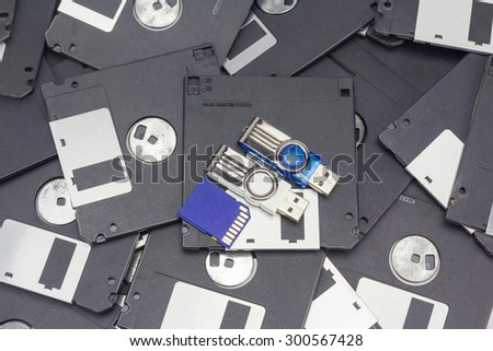 Usb flash memory, SD card and floppy disk - stock photo