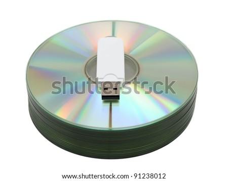 USB stick on CD stack against white background - stock photo