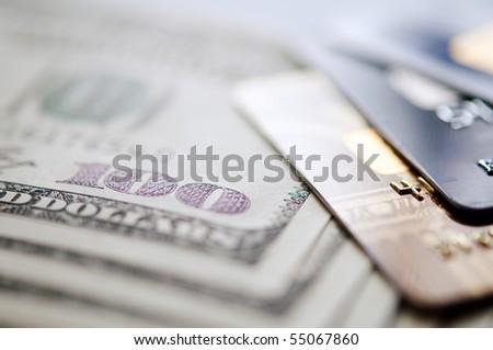 USD and credit card. selective focus. closeup. - stock photo