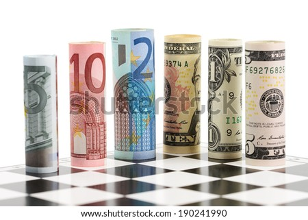 USD and Euro bank notes on chess board - stock photo
