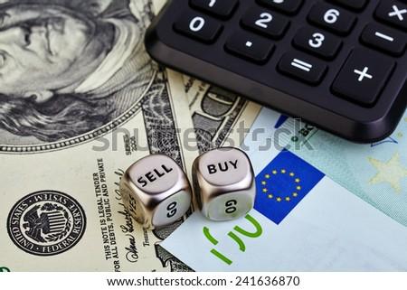 USD EUR banknotes, dices cubes, calculator. Selective focus - stock photo