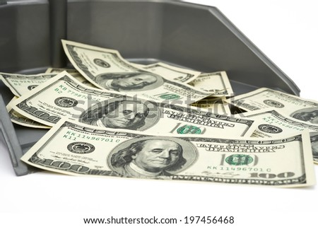 USD paper currency in trash bin, financial concept