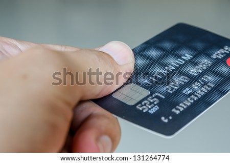 Use a credit card - stock photo