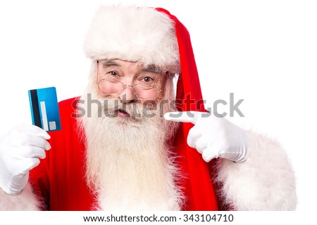 Use credit card to buy christmas gifts - stock photo