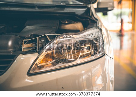 Use headlights to illuminate the journey. - stock photo