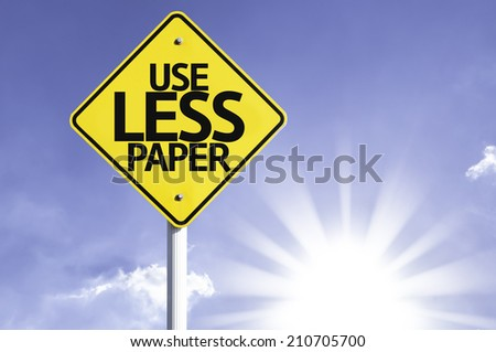 Use Less Paper road sign with sun background  - stock photo