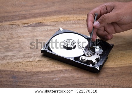 Use Screwdriver to remove screw to check Hard Disk Drive