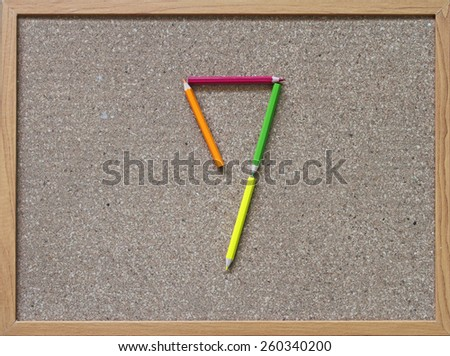 Use the pencil to make number - stock photo