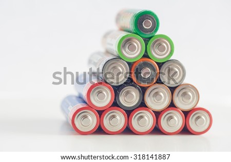Used AA batteries in several colors, selective focus