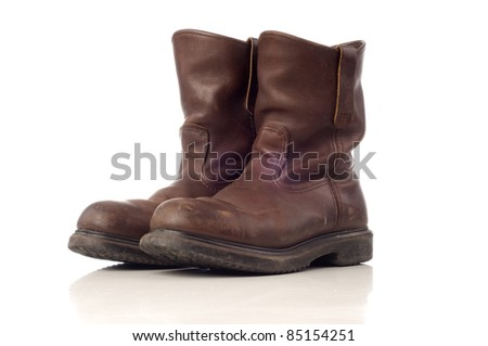 Used afety boots in brown color isolated white background - stock photo