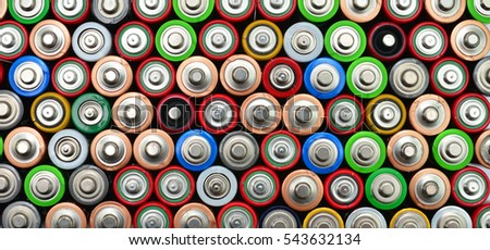 used alkaline battery pattern background top view