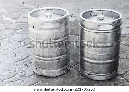 Used aluminum kegs, small barrels commonly used to store, transport, and serve beer - stock photo