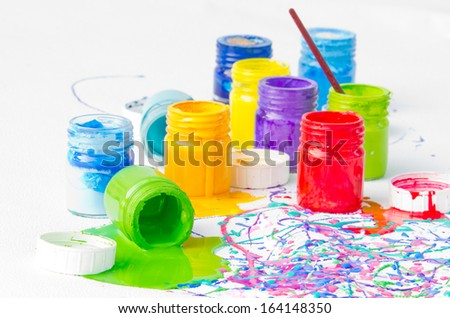 Used and spilled plastic paint bottles - stock photo